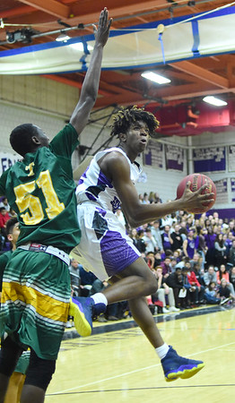 GILLIAN JONES — THE BERKSHIRE EAGLE<br /> Taconic's Mohamed Sanaogo tries to block Pittsfield's Craig Jackson as he goes for the basket during the first half of the game in Pittsfield. Monday, February 12, 2018.