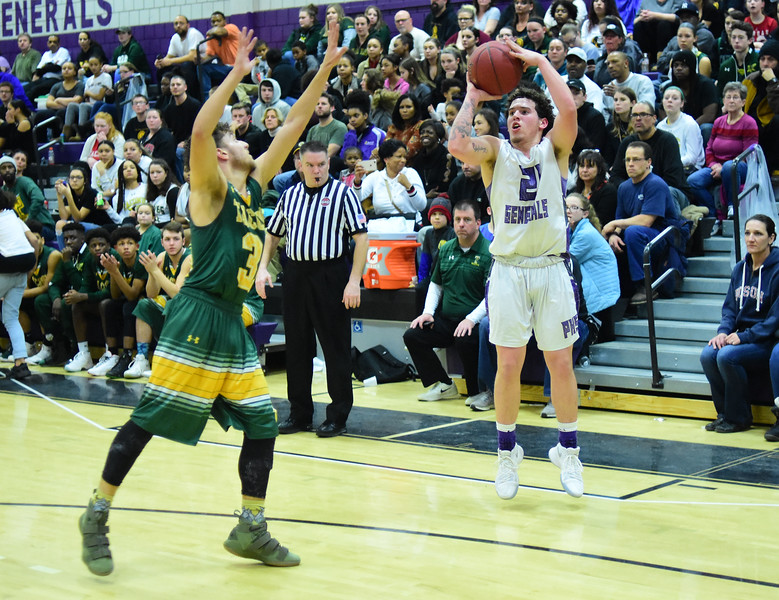 GILLIAN JONES — THE BERKSHIRE EAGLE<br /> Taconic's Jayden Cross tries to block Pittsfield's Edwin Rodriguez  as he goes for the basket during the first half of the game in Pittsfield. Monday, February 12, 2018.