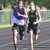 GILLIAN JONES — THE BERKSHIRE EAGLE<br /> While staying in second place for most of the race, Pittsfield's Amin Purry passes Taconic's Chris Adams to finish first in the mile during a track meet at Wahconah on Monday, May 14, 2018.