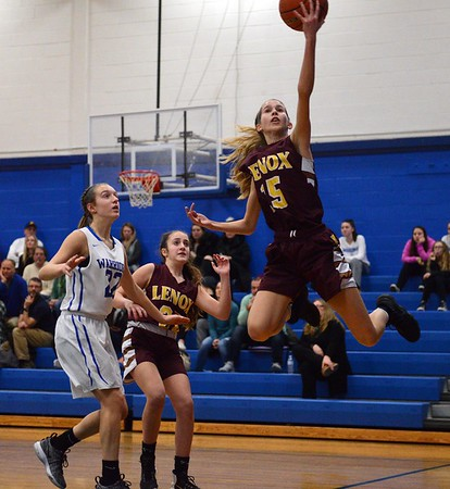 GEOFF SMITH — THE BERKSHIRE EAGLE<br /> Lenox's Julie Pehlert goes airborn to try and save the ball from going out of bounds during Friday's game against Wahconah in Dalton.