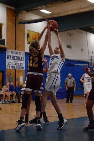 GEOFF SMITH — THE BERKSHIRE EAGLE<br /> Wahconah's Becca Morris goes up for a shot at Lenox's Sophie Patella tries to block her during a game Friday in Dalton.