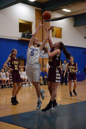 GEOFF SMITH — THE BERKSHIRE EAGLE<br /> Wahconah's Abbie Steinman goes up for a shot as Lenox's Mia Giardina tries to guard her during a game Friday in Dalton.