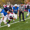 Gabe Verdi upends the Frontier runningback during the second quarter.