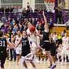 Bobby Casey (11) drives through the paint for a late in the second half for Williams.