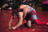 Hunter Avrial, from Mount Greylock, attempts to pin down his opponent during a wrestling match at Mount Greylock High School Saturday. (Jack Guerino/North Adams Transcript)