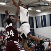 Lorain's Marqua Black -Wright finger rolls a shot over Daray Mennifield of Maple Heights during the second quarter. Randy Meyers -- The Morning Journal