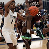 Maple Heights guard Marcus Kimmie drives the lane past Octavious Wilson of Lorain during the third quarter. Randy Meyers -- The Morning Journal