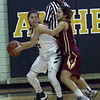 Amherst guard Audrey McConihe looks to pass and is defended closely by Amber Achladis of Avon Lake. Randy Meyers -- The Morning Journal