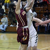 Jayla Hall of Amherst battles Hannah Oehlstrom of Avon Lake for a rebound during the second quarter. Randy Meyers -- The Morning Journal