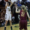 Amherst guard Kamryn Dziak fires a three point shot in front of Grace Dean of Avon Lake during the second quarter. Randy Meyers -- The Morning Journal