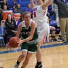 Elyria Catholic's Sam Fillaggi scrambles to keep the ball inbounds on a rebound.  Amanda K. Rundle -- The Morning Journal