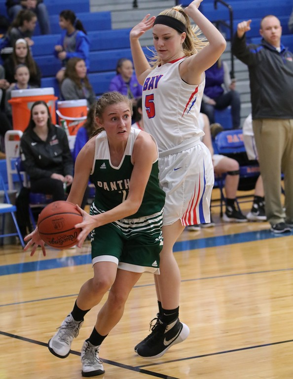 . Elyria Catholic\'s Sam Fillaggi scrambles to keep the ball inbounds on a rebound.  Amanda K. Rundle -- The Morning Journal