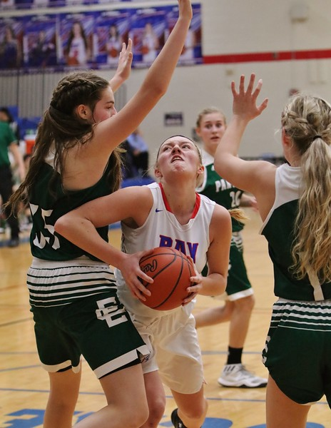 Bay 's Maddie Edgerly looks to make a shot through the Elyria Catholic defenders. Amanda K. Rundle -- The Morning Journal