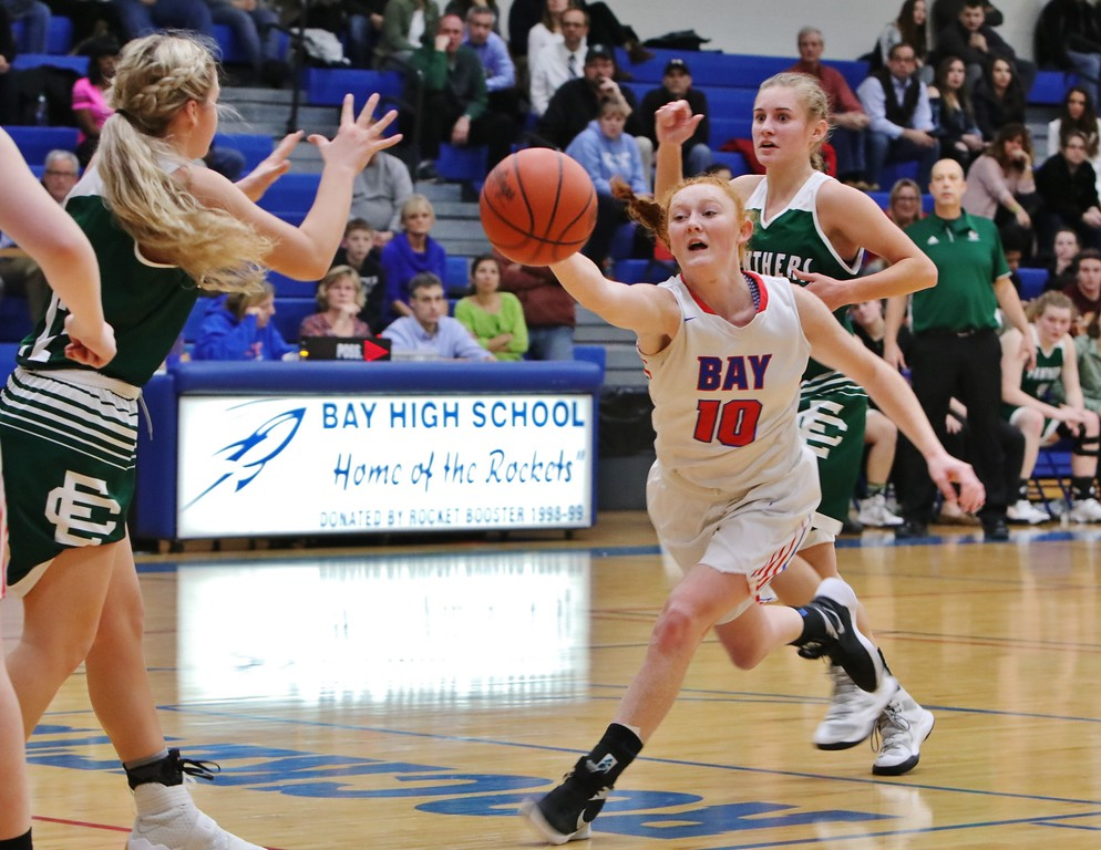 . Bay\'s Maddie Holmes reaches for a loose ball while an Elyria Catholic defense waits to grab the turnover. Amanda K. Rundle -- The Morning Journal