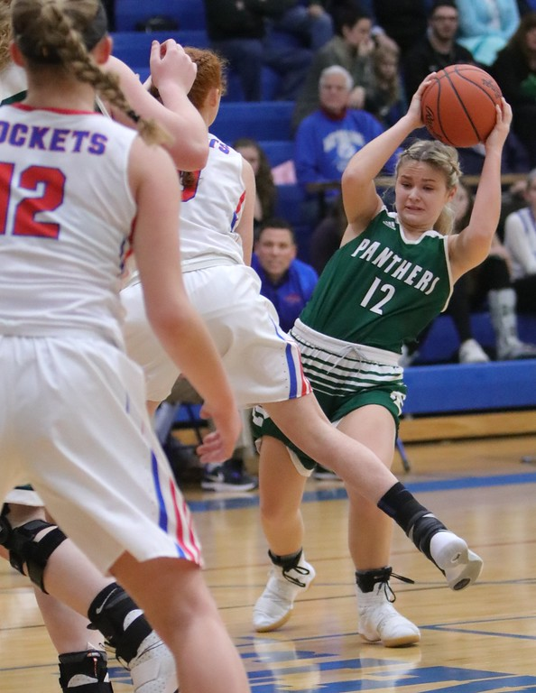 . Elyria Catholic\'s Faith Williams looks to pass. Amanda K. Rundle -- The Morning Journal