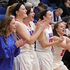 The Bay bench cheers on their teammates. Amanda K. Rundle -- The Morning Journal
