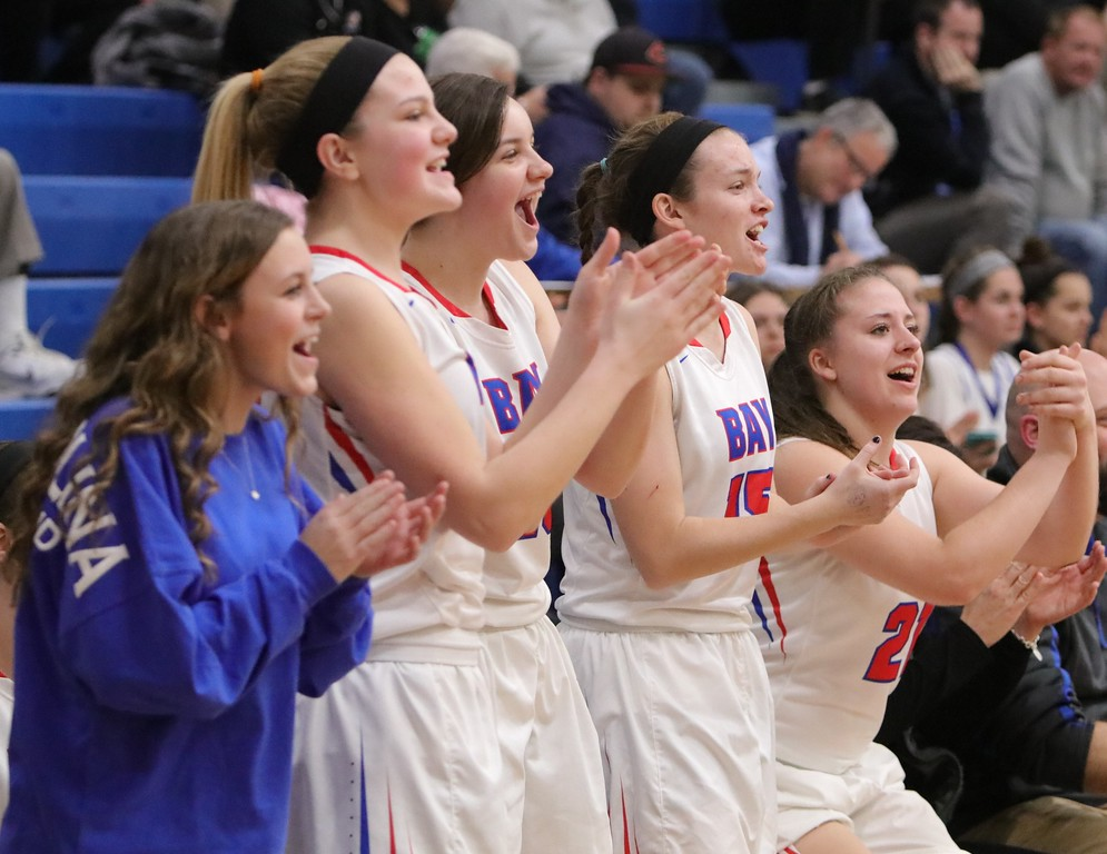 . The Bay bench cheers on their teammates. Amanda K. Rundle -- The Morning Journal