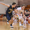 Avon Lake's Carson Toy (21) drives to the paint past Olmsted Falls' Eric Hanna (3), Jan. 13, 2017. Eric Bonzar — The Morning Journal