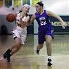 Kamryn Dziak of Amherst drives to the basket against the defense applied by Avon's Juliann Walker. Randy Meyers -- The Morning Journal