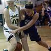 Kamryn Dziak of Amherst battles Juliann Walker of Avon for a loose ball during the second quarter. Randy Meyers -- The Morning Journal