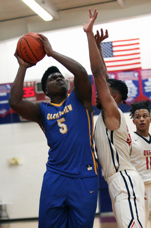 . Clearview\'s DeAri Todd shoots over Donald Johnson of Oberlin during the third quarter. Randy Meyers -- The Morning Journal