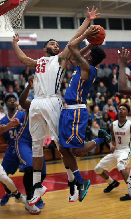 . Clearview\'s Jamel Billings gets a shot off over Oberlin\'s Donald Johnson during the second quarter. Randy Meyers -- The Morning Journal