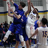 Bay's Christian Dupps pulls down a rebound in front of Jamel Billings of Clearview during the second quarter. Randy Meyers -- The Morning Journal