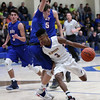 Clearview's Jamel Billings drives the lane past Daniel Brajdic of Bay during the second quarter. Randy Meyers -- The Morning Journal