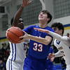Bay's Christian Dupps is fouled by Evan Berrios of Clearview, right, as he attempts a shot during the first quarter. Randy Meyers -- The Morning Journal