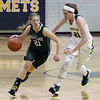 Westlake's Kate Pavilonis brings the ball up court against the defense applied by Kate Iliff of Amherst during the third quarter. Randy Meyers -- The Morning Journal