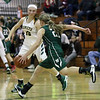 Westlake guard Kate Pavilonis brings the ball up court against the pressure applied by Kamryn Dziak of Amherst during the second quarter. Randy Meyers -- The Morning Journal