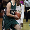 Katarina Jamsek of Westlake drives by Jayla Hall of Amherst and scores during the third quarter. Randy Meyers -- The Morning Journal