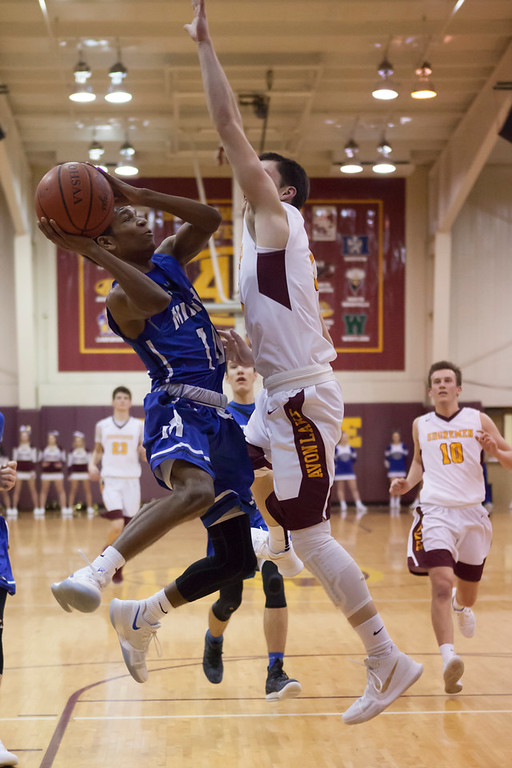 . Midview\'s Isiah Johnson exhibits some agility when Avon Lake\'s Andrew Butrey defends against his jump shot.  Jen Forbus -- The Morning Journal