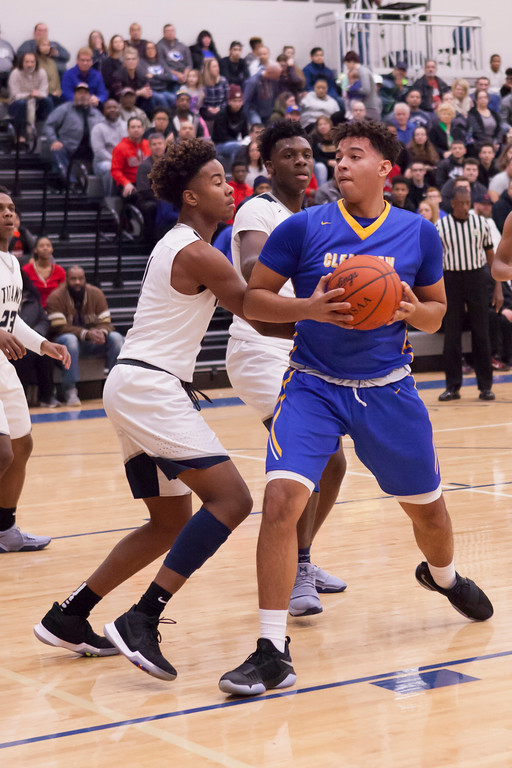 . Lorain\'s Taevon Pierre-Louis, right, and Jordan Jackson make sure Clipper Anthony Terry\'s path to the basket is blocked. Jen Forbus -- The Morning Journal