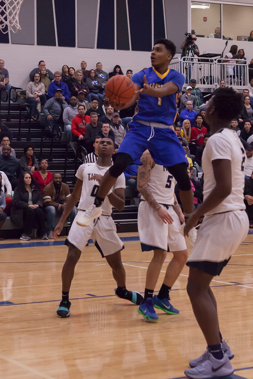 . learview\'s Sam Daniels finds some altitude to make a shot against the Lorain Titans. Jen Forbus -- The Morning Journal