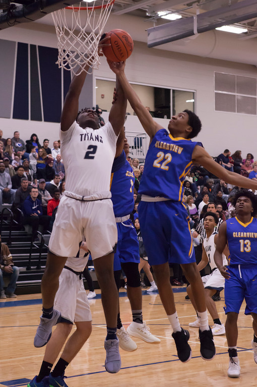 . Clearview\'s Jamir Billings tries to sink a shot, but Lorain\'s Taevon Pierre-Louis has other plans. Jen Forbus --The Morning Journal