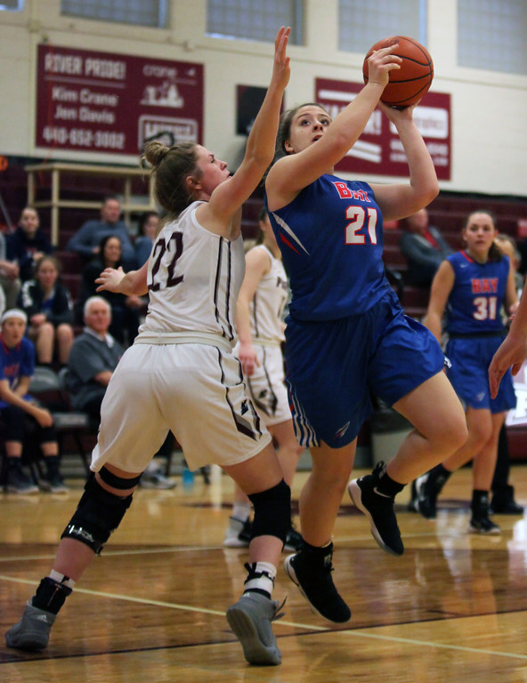 . Haley Andrejcak of Bay drives left and shoots over Bridget McCue of Rocky River during the third quarter. Randy Meyers -- The Morning Journal