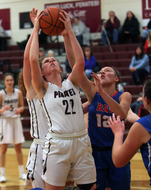 . Bridget McCue of Rocky River pulls down a rebound in front of Maddie Edgerly of Bay during the third quarter. Randy Meyers -- The Morning Journal