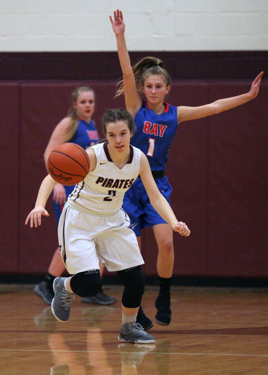 . Lauren Cain of Rocky River chases a deflected pass in front of Bay defender Kayla Koz during the first quarter. Randy Meyers -- The Morning Journal