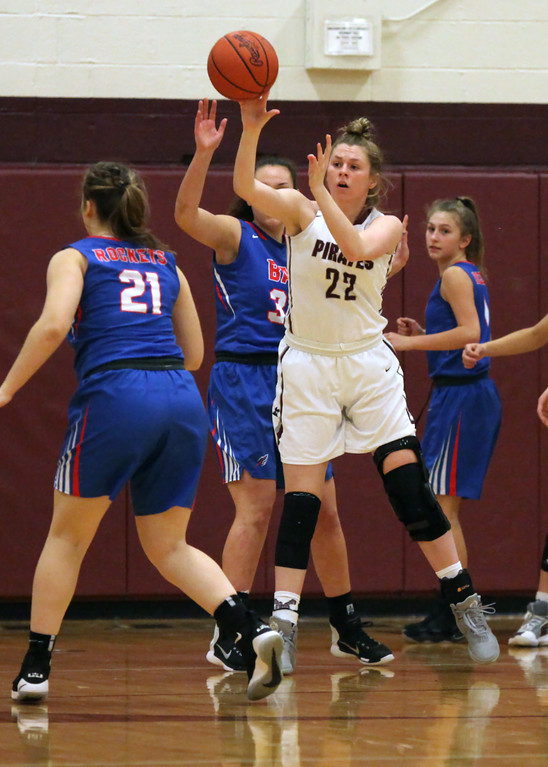 . Bridget McCue of Rocky River passes away from the Bay defense in the low post during the first quarter. Randy Meyers -- The Morning Journal