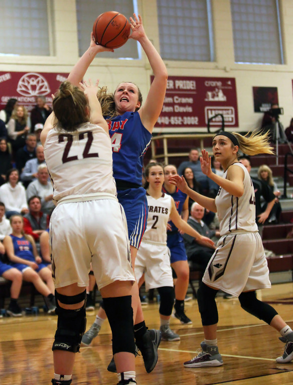 . Bay\'s Halle Orr puts up a shot over Bridget McCue of Rocky River during the third quarter. Randy Meyers -- The Morning Journal