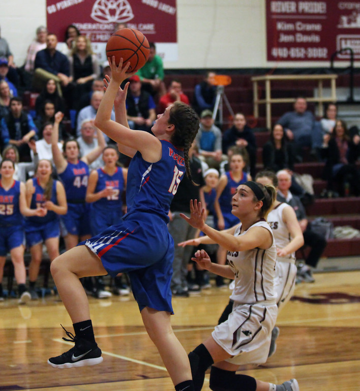 . Grace Linehan of Bay drives and scores in front of Hanna Chapman of Rocky River during the third quarter. Randy Meyers -- The Morning Journal