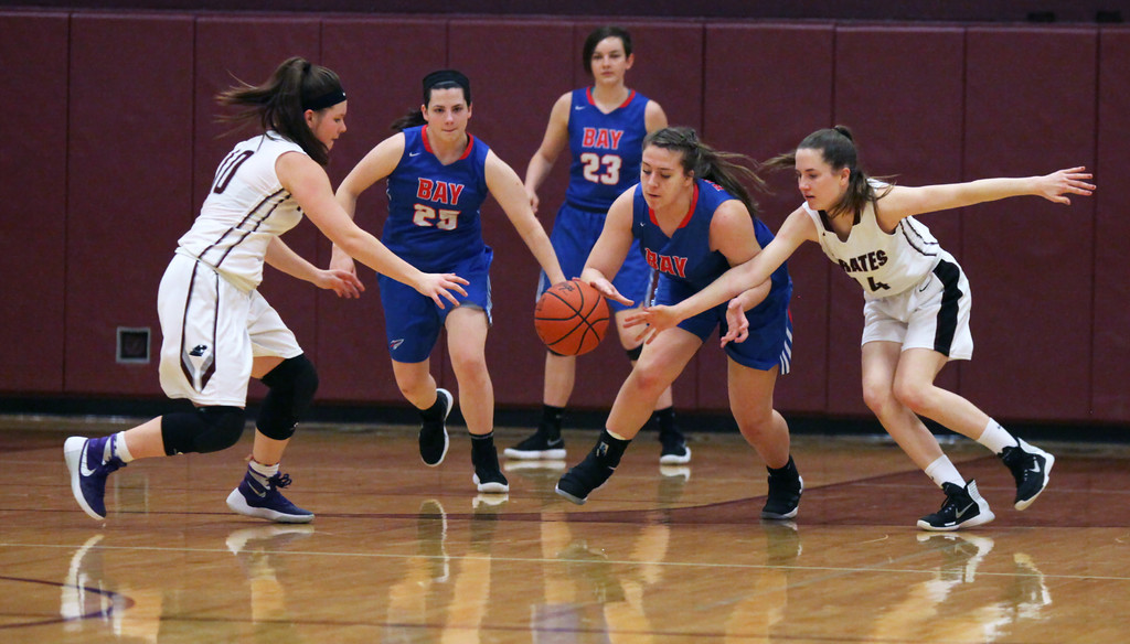 . Nani Meese and Julia Potts of Rocky River react to a loose ball in front of Bay\'s Haley Andrejcak during the first quarter. Randy Meyers -- The Morning Journal