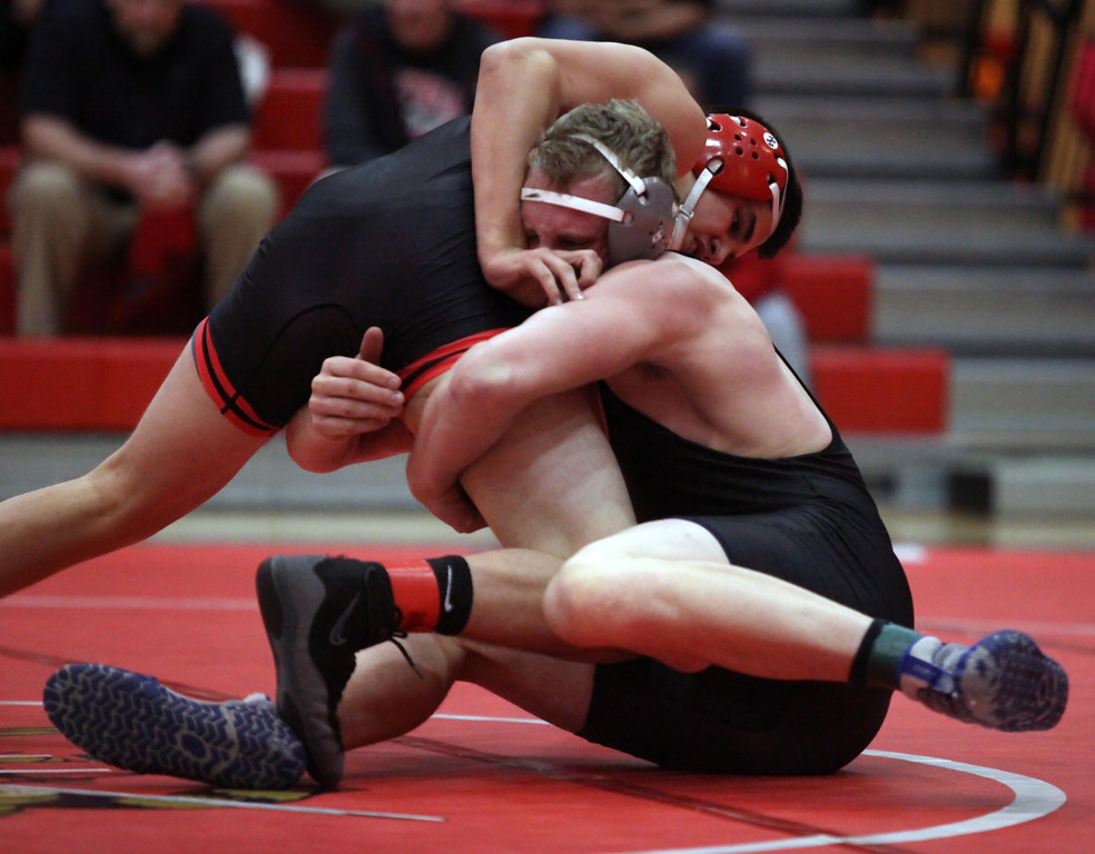. idview\'s Seth Frambach wrestles Andrew Levis of Elyria during the 195-pound match. Randy Meyers -- The Morning Journal
