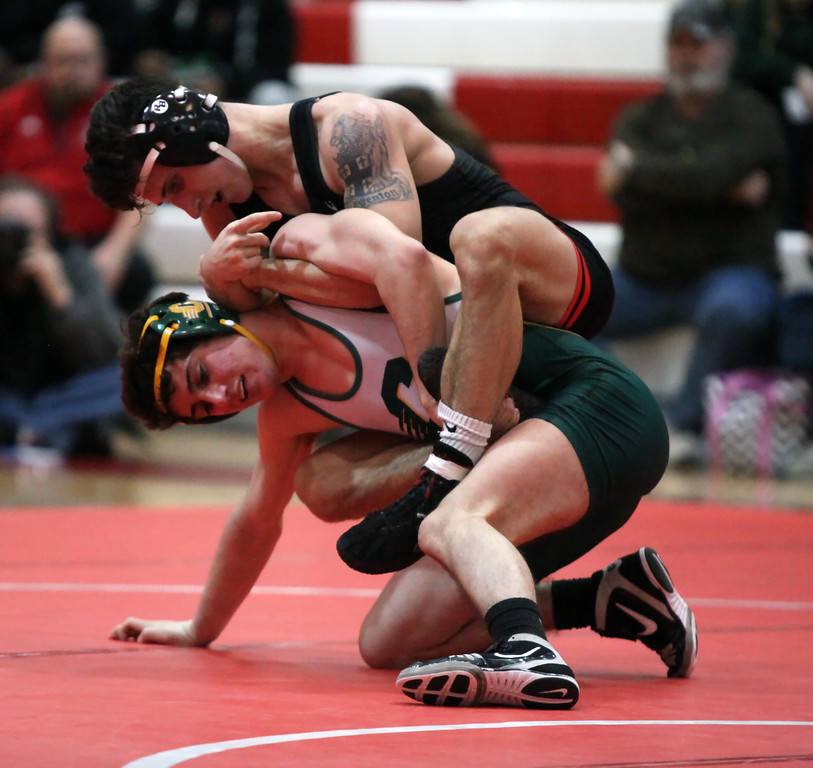 . Elyria\'s Brendon Fenton has a hold advantage over Clay\'s Kyle Maville during the 120-pound match. Randy Meyers -- The Morning Journal