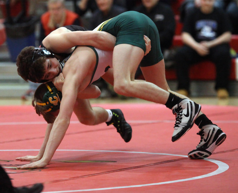 . Dylan Shawver of Elyria forces Jacob Moon of Clay to the mat during the 120-pound regional final. Randy Meyers -- The Morning Journal