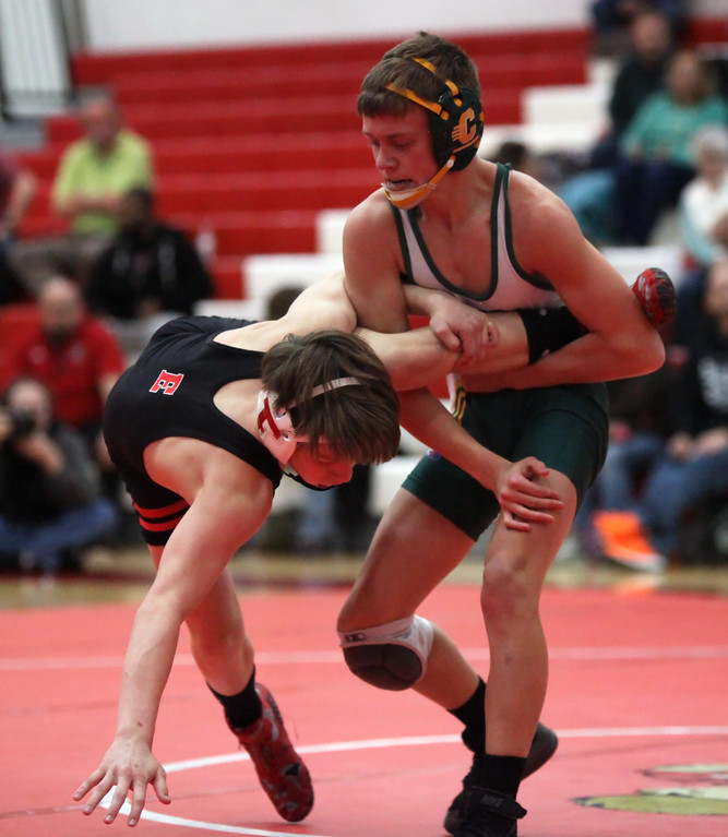 . Clay\'s Tony Pendergraff has a leg hold on Colin Noel of Elyria during the 106-pound match. Randy Meyers -- The Morning Journal