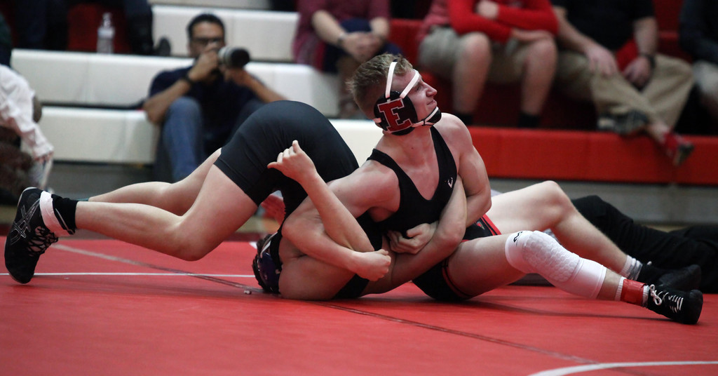 . Elyria\'s Noah Mencke is close to a pin of Dustin Wells of Midview during the 170-pound match. Randy Meyers -- The Morning Journal