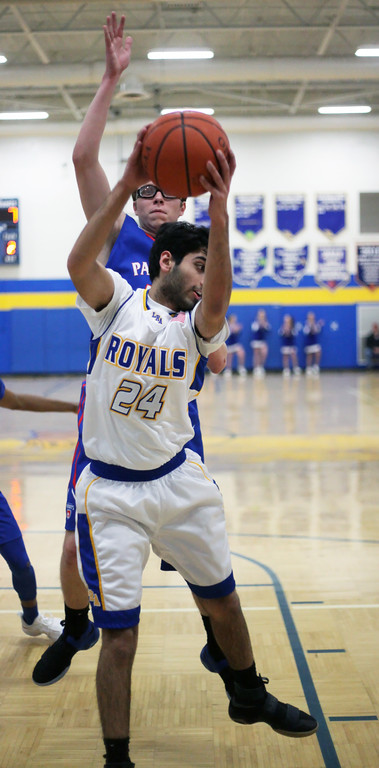 . Nanak Dhillon of Lake Ridge Acadamy pulls down a rebound in front of Maxx Wiley of Open Door during the first quarter. Randy Meyers -- The Morning Journal