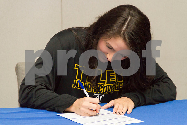 Photo by Shannon Wilson / Tyler Morning Telegraph Rilee Miller, a senior from Grace Community High School, signs with Tyler Junior College for volleyball on Wednesday morning in the conference room at Grace Community High School.